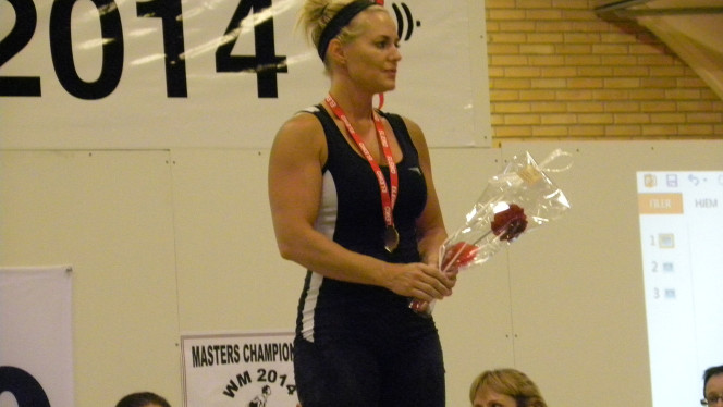 Local mother wins world weightlifting championship