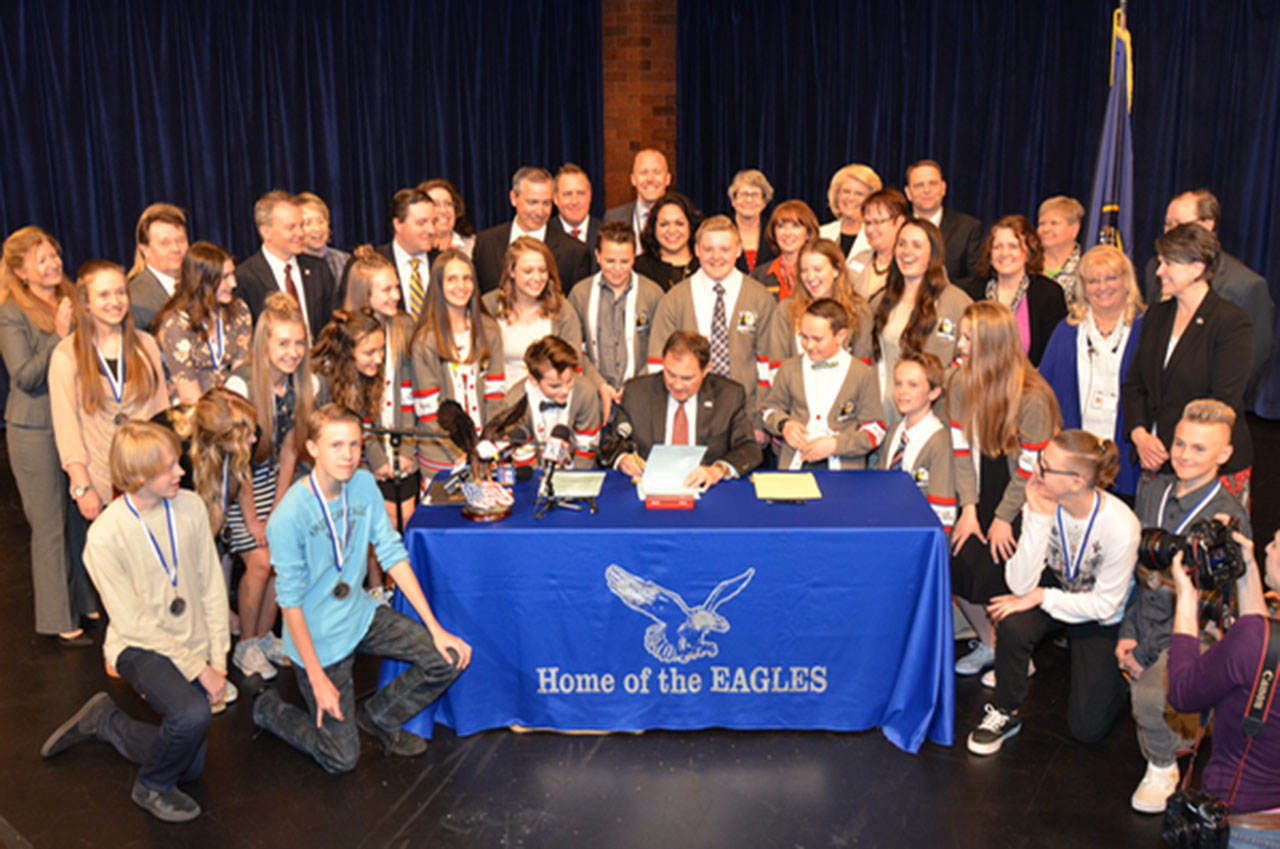 Governor signs education budget into law at Riverton school