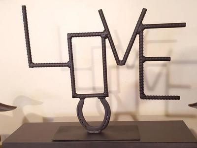 Rebar and horseshoe LOVE table sign