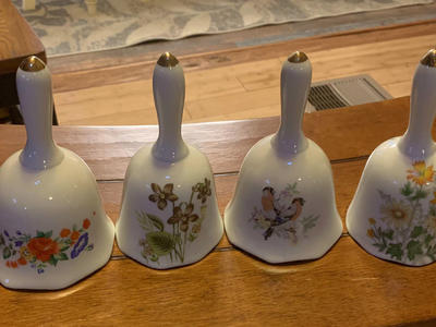 Four beautiful vintage porcelain bells