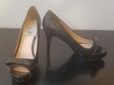 "Black Nine West 4"" heels with bow.  Size 7M"