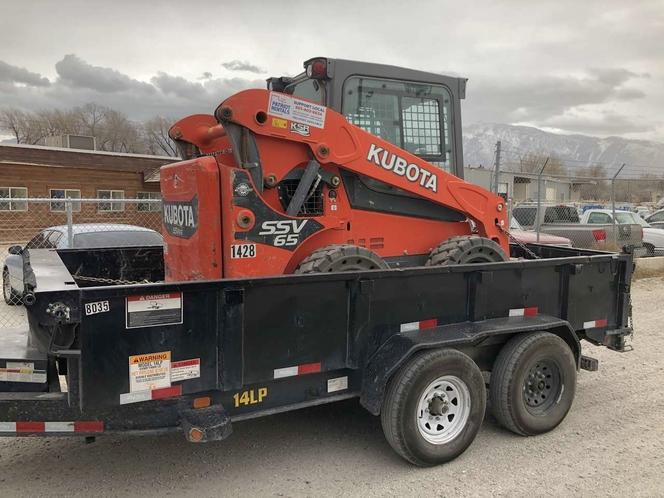 Skid steer & dump trailer combo package. Bobcat loads into dump trailer for sale in Salt Lake City , UT