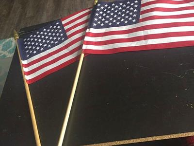 American Flag On Wooden Rods