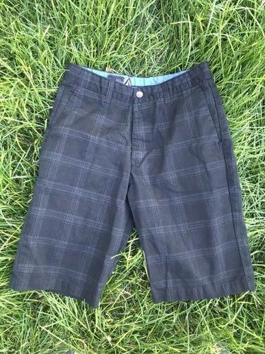 Boys Size 16/28 Volcom Shorts Black Plaid for sale in Riverton , UT