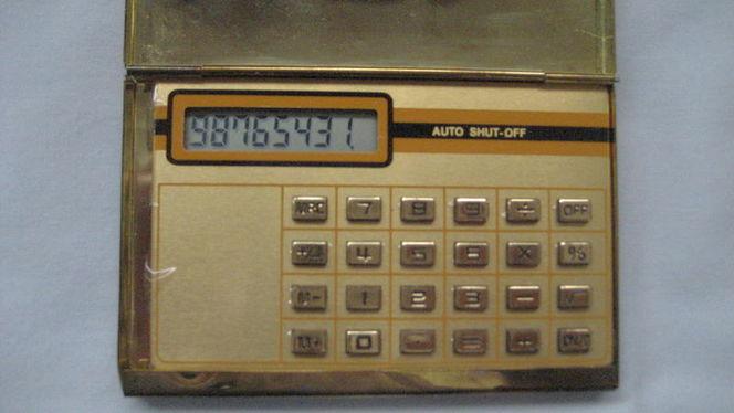 Vintage Calculator in Golden Metal Case for sale in West Valley City , UT