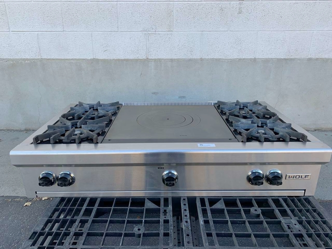 2011 Wolf Range Top - Four Gas Burners - French Cook Top - Stainless Steel - Excellent Used Condition for sale in Salt Lake City , UT
