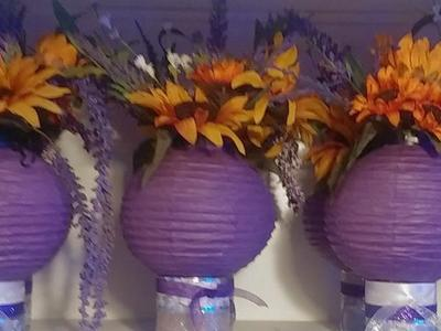 Center pieces lanterns purple sunflowers Wedding