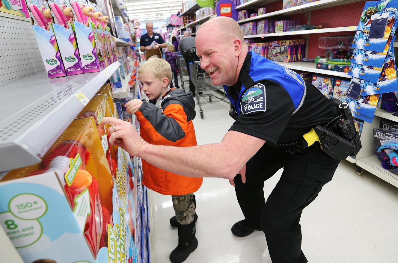 police officers help underprivileged kids shop for christmas ksl com