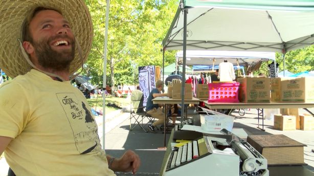 S.L. flea market features old-fashioned texting via old typewriter