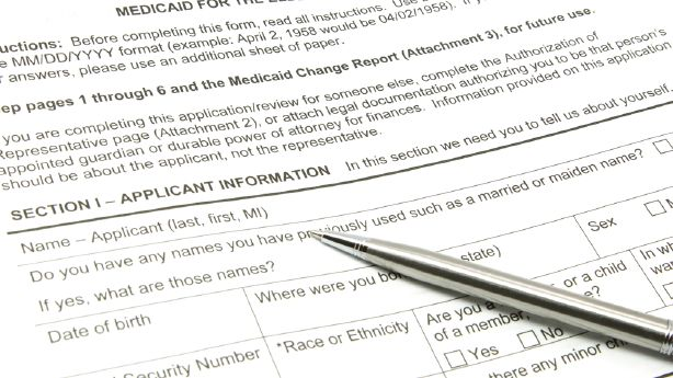 2 charged with forging signatures on Medicaid expansion