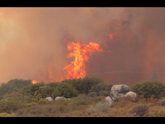 \'Terrifying\' tornados of flame burn California city; 2 dead