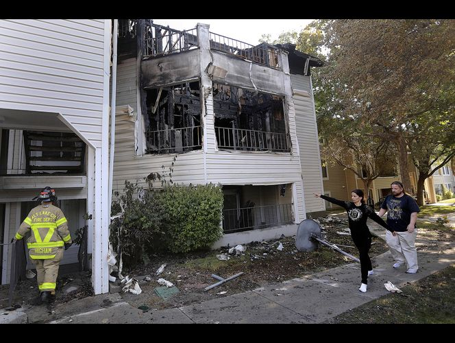 Woman jumps from burning building; 12 apartments destroyed