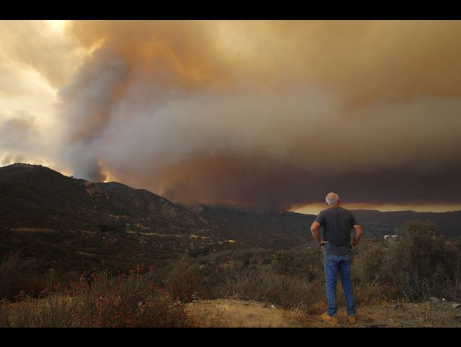 14,000 fight California fires, some from prisons or overseas