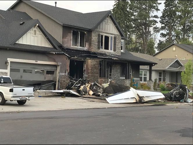 Pilot dies after crashing plane into his own home, police say