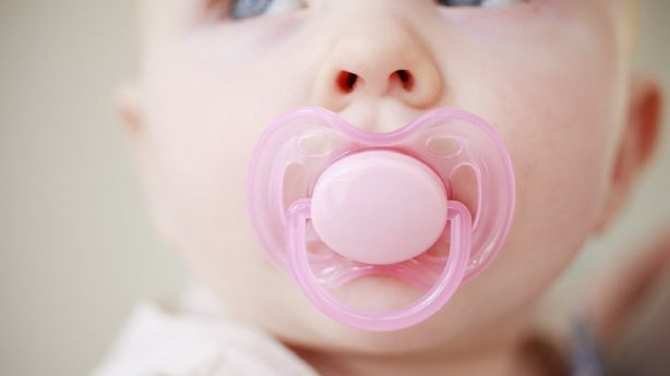 Sucking your baby's pacifier could protect her from allergies, the study said