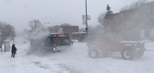 Have You Seen This? 3 vehicles pull bus full of passengers up snowy hill