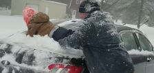 Have You Seen This? Dad uses son to get snow off car