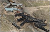 Crews detonate 11 train cars in 'fireball' as part of