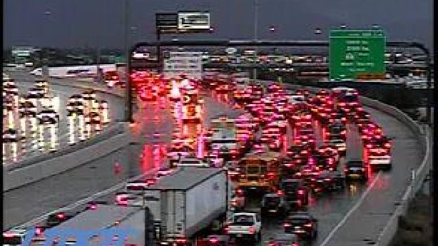 Jack-knifed semitruck, fuel spill closes lanes on southbound I-15