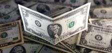 Dollar finishes week stronger as U.S. data hurts risk appetite