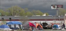Property owner calls on city to fix issues at nearby homeless camp