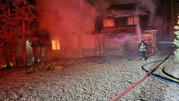 Fire destroys cabin home in Duck Creek Village; losses estimated at $2M