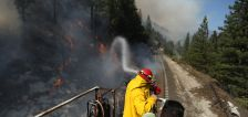 Hot, gusty winds fanning flames of massive US wildfires