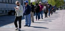 US weekly jobless claims fall; layoffs lowest in more than 21 years